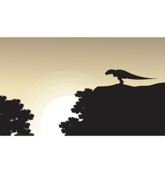 On the cliff tyrannosaurus scenery of silhouettes vector