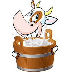 Cow holding a pail full of milk - vector