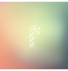 Candy cane icon on blurred background vector