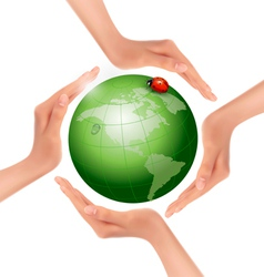 Hands holding a green earth with a ladybug vector