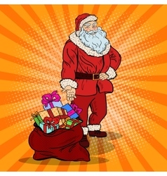 Pop art smiling santa claus with bag gifts vector