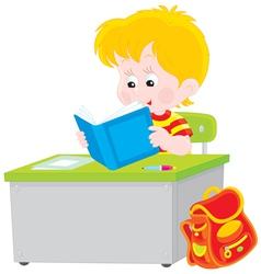Schoolboy reading a textbook vector