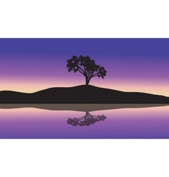 Landscape with silhouette of a single tree vector