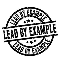Lead by example round grunge black stamp vector