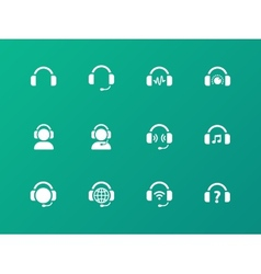 Earphones icons on green background vector image