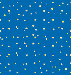 Seamless pattern with small yellow stars on blue vector