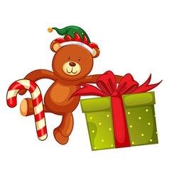 Teddy bear and christmas present vector