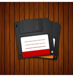 Modern diskette on wooden background vector
