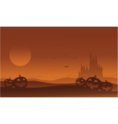 Silhouette of castle and pumpkins halloween vector