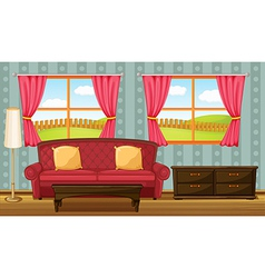 A red sofa and side table vector image vector image