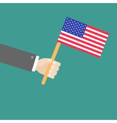 Businessman hand holding american flag flat design vector
