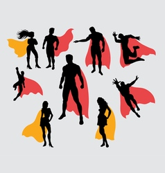Superman and supergirl silhouettes vector