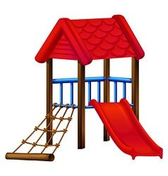 A toy house at the park with a slide vector