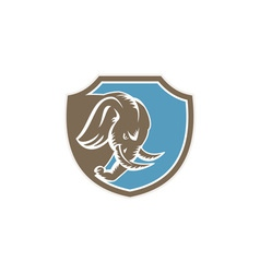 Angry elephant head side shield retro vector