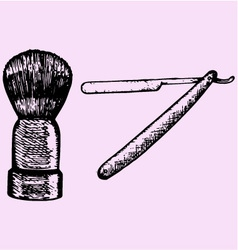 Straight razor and shaving brush vector