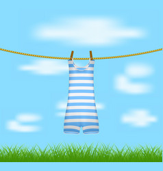 Striped retro swimsuit hanging on rope vector