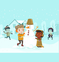 Multicultural children making a snowman vector