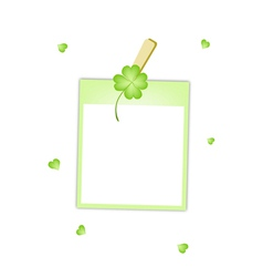 Blank photos with clover hanging on clothesline vector