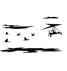 cranes and motorized hang glider vector image vector image