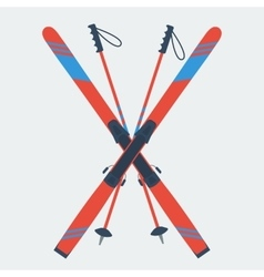 Pair of red skis and ski poles vector