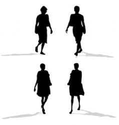 Women walking silhouettes vector