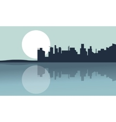 Silhouette of city and reflection with full moon vector image