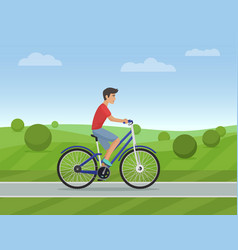 young man riding a sport bike on a park road vector image vector image