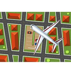 Aerial view of airplane flying over neighborhood vector