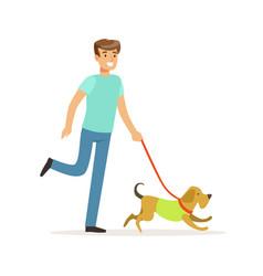 young smiling man walking a dog vector image