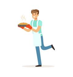 Young smiling man holding fresh baked pie house vector