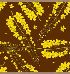 cassia fistula - golden shower flower on brown vector image vector image