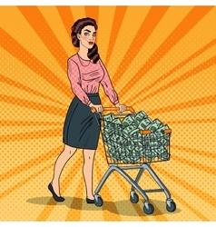 Pop art woman with shopping cart full of money vector