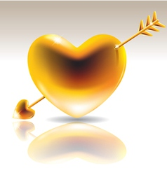 Golden heart with arrow vector