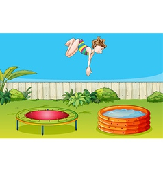 A girl playing trampoline vector image