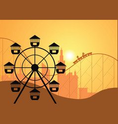 silhouettes of a city and amusement park with the vector image