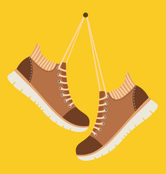 Brown shoes hang on laces vector