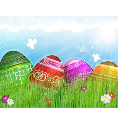 Painted Easter eggs on meadow vector image vector image