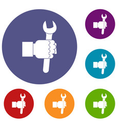 Wrench tool in man hand icons set vector