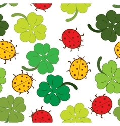 Ladybugs and clover leaves seamless pattern vector image