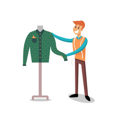 Male dressmaker working at sewing atelier fashion vector