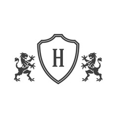 Heraldic lions and monogram on shield isolated on vector
