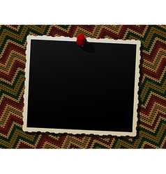 Photo frame over a knitted background vector