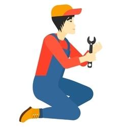 Repairman holding spanner vector