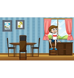 A boy sitting above the cabinet near the window vector