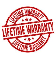Lifetime warranty round red grunge stamp vector