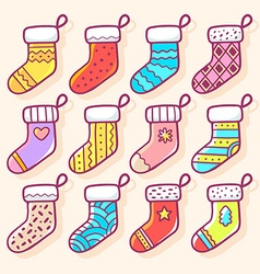 Various christmas decorated socks on ligh vector