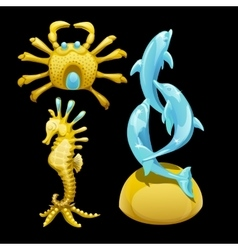 Golden figure of a crab seahorse and dolphins vector