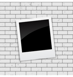 Instant photos on grunge brick background vector