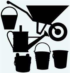 Garden wheelbarrow watering can and buckets vector