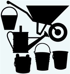 Garden wheelbarrow watering can and buckets vector image